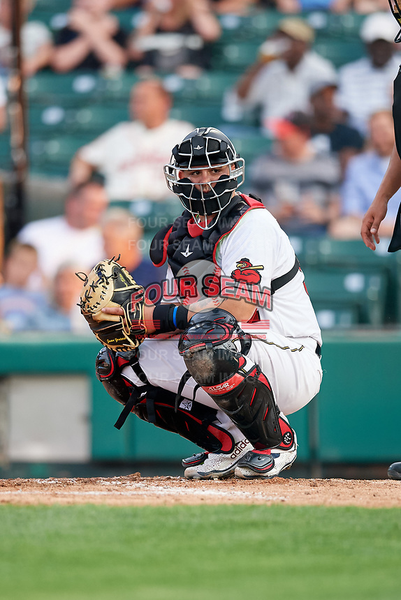 Rochester Red Wings catcher Juan Graterol (52) looks into the dugout during a game against the Lehigh Valley IronPigs on June 30, 2018 at Frontier Field in Rochester, New York.  Lehigh Valley defeated Rochester 6-2.  (Mike Janes/Four Seam Images)
