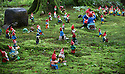 29/05/15<br /> <br /> If you go down in the woods today you'll be sure of a gnome surprise.<br /> <br /> For one group of hardy folk, today's rain only adds to the fun that can be had by the beach, fishing in the river, or playing in the woods.<br /> <br /> The gnomes, and a few pixies and fairies, make up a collection, now believed to be close to 2,000 individuals, that 'live' at the Gnome Reserve near Bideford, North Devon.<br /> <br /> Visitors are asked to wear gnome hats, so as not to scare the gnomes who feature as the largest collection in the Guinness Book of World Records. <br /> <br /> Ann Atkin's collection began in 1979 and features traditional gnomes on toad-stools to Olympian athletes, astronauts who work for 'GNASA', a beach scene complete with gnomes in bikinis, a queue for the ice-cream van, Punch and Judy gnomes and another floating on a lilo. Other gnomes can be scene kissing, and flashing their bottoms as the visit the Gents and Ladies toilets. <br /> <br /> <br /> All Rights Reserved - F Stop Press.  www.fstoppress.com. Tel: +44 (0)1335 418629 +44(0)7765 242650