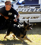 Enfield Canine Officer Matthew Worden Wednesday, with his canine partner is ready to go after the bad guy, during a training exercise,  Wednesday, Sept. 25, 2013, outside a vacant warehouse on on Choice Road in Windsor Locks.  Doug Humphrey, a retired East Windsor police officer who now runs Apex Predator K9 Services, runs  this monthly in service canine training program. Humphrey says he has about fifteen canine units from as far as New Haven as regular participants. Seven dogs from five departments were on hand Wednesday drilling on canine use in patrol and narcotics scenarios. (Jim Michaud / Journal Inquirer)