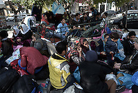 Pictured: Dozens of migrants crammed in a corner of the square Friday 26 February 2016<br /> Re: Hundreds of refugees have temporarily camped at Victoria Square in central Athens, Greece.