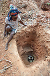Gold miners digging and panning for gold in the forests near Andranotsimaty, Daraina, north east Madagascar.