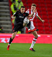 1st October 2021;  Bet365 Stadium, Stoke, Staffordshire, England; EFL Championship football, Stoke City versus West Bromwich Albion; Jordan Hugill of West Bromwich Albion is tackled by Harry Souttar of Stoke City
