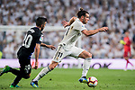 Gareth Bale of Real Madrid is followed by Michael Nicolas Santos Rosadilla of CD Leganes during the La Liga 2018-19 match between Real Madrid and CD Leganes at Estadio Santiago Bernabeu on September 01 2018 in Madrid, Spain. Photo by Diego Souto / Power Sport Images
