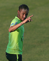 Neymar of Brazil appears in relaxed mood as he gestures to the media during training ahead of tomorrow's World Cup quarter final vs Colombia tomorrow