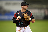 Batavia Muckdogs third baseman Bubba Hollins (34) warms up in between innings during a game against the Williamsport Crosscutters on August 3, 2017 at Dwyer Stadium in Batavia, New York.  Williamsport defeated Batavia 2-1.  (Mike Janes/Four Seam Images)