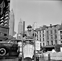 A stevedore who packs and loads crates of fish on the lower east side. New York, New York, 1943.<br /> <br /> Photo by Gordon Parks.