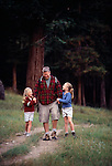 A father and his daughters enjoy each other while hiking along a trail in Rocky Mtn Nat'l Park, CO