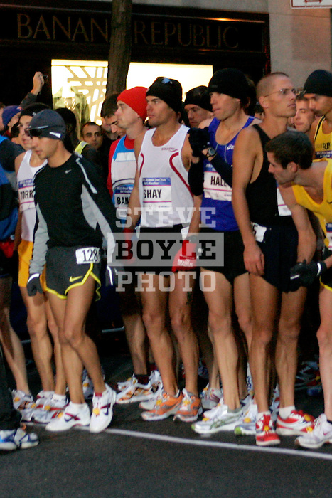 Ryan Shay (white tank) prepares for the start of the 2008 Men's Olympic Trials Marathon on November 3, 2007 in New York, New York.  The race began at 50th Street and Fifth Avenue and finished in Central Park.  Ryan Hall won the race with a time of 2:09:02.