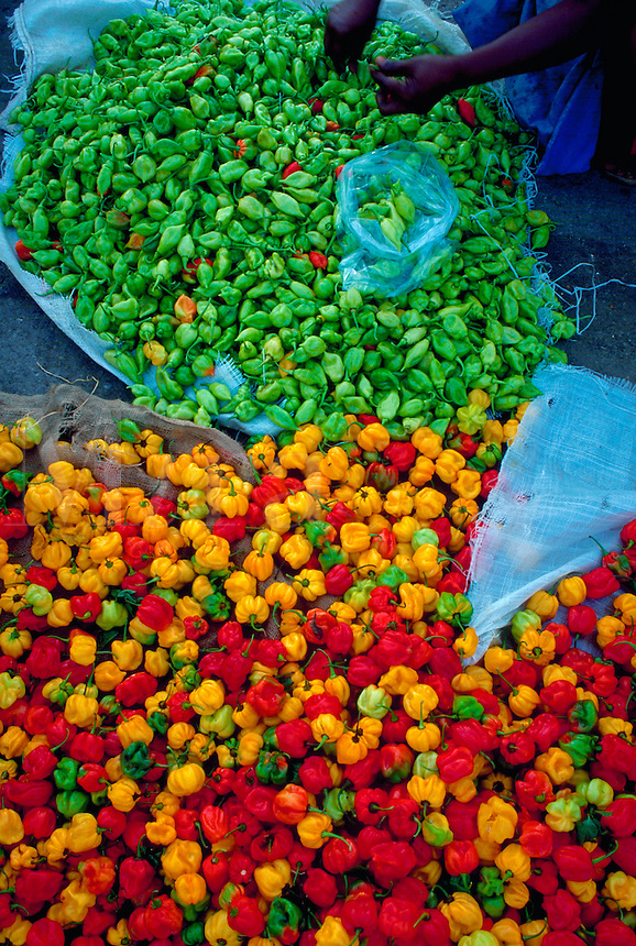 Woman sorting peppers in Central Market, Port of Spain