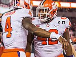 Alabama quarterback Deshaun Watson (4) and Christian Wilkins (42) celebrate Watson's touchdown against Alabama in the first half of the 2017 College Football Playoff National Championship in Tampa, Florida on January 9, 2017.  Photo by Mark Wallheiser/UPI
