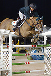 Darragh Kerins and Night Train compete for Ireland in the $75,000 FEI Nations Cup, an Olympics-style show jumping event, on Friday night, Feb. 28, 2009, during the Winter Equestrian festival in Wellington, Fla. Canada won the eight-nation, two-round competition before the first sellout (8,000) at the recently-renovated Palm Beach International Equestrian Center. Canada edged Ireland and Great Britain (tie) for the blue ribbons, followed by the United States. Also competing were teams from Argentina, France, Mexico and Venezuela. Thousands of cheering, flag-waving fans packed the International Arena at the WEF grounds for the Nations Cup, reportedly the oldest and most prestigious team show jumping competition in the world. Photo by Daphne Markey