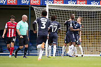 Jason Demetriou, Southend United celebrates with tea,m mates following his successful penalty restored the lead during Southend United vs Exeter City, Sky Bet EFL League 2 Football at Roots Hall on 10th October 2020