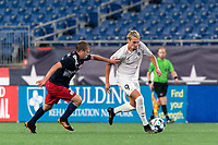 FOXBOROUGH, MA - SEPTEMBER 1: Deri Corfe #9 of FC Tucson brings the ball forward as Sean O'Hearn #40 of New England Revolution II defends during a game between FC Tucson and New England Revolution II at Gillette Stadium on September 1, 2021 in Foxborough, Massachusetts.