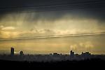 © Joel Goodman - 07973 332324 . 20/02/2014 .  Manchester , UK . Landscape view across Manchester taken from Saddleworth near Oldham . Photo credit : Joel Goodman