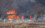 A 400-acre brush fire burns in south Reno, Nev., on Friday, Nov. 18, 2011. More than 20 homes have been lost and the fire continues to burn out of control in high winds with gusts up to 60 mph. (AP Photo/Cathleen Allison)