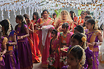 """Hindu community UK. Ritusuddhi, also called as Ritu Kala Samskara, is the coming of age ceremony for girls, after menarche or first menstruation. This milestone in a girl's life is observed by her family and friends, with gifts and her wearing a sari for the ritual. """"Coming of Age""""  puberty party celebration London Uk  Wealthy middle class Hindu family put on a lavish party for their 16yr old daughter.  500 guests for a day long celebration. Event in local school hall."""