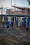 FC Halifax Town 1 Mickleover Sports 1, 23/04/2011. The Shay, Northern Premier League. Home team supporters paying entering through the turnstiles at The Shay, home of FC Halifax Town, on the day that they were presented with the Northern Premier League Premier Division championship trophy following their match with Mickleover Sports. The club replaced Halifax Town A.F.C. who went into administration during the 2007–08 season, having previously been members of the Football League for 80 years. Their promotion meant they would play in Conference North in the 2011-12 season. Photo by Colin McPherson.