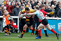 Richmond Rugby attack with Ben Ransom of Blackheath Rugby trying to stop them during the English National League match between Richmond and Blackheath  at Richmond Athletic Ground, Richmond, United Kingdom on 4 January 2020. Photo by Carlton Myrie.