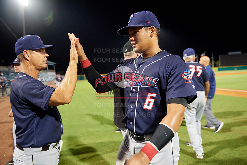 Jacksonville Jumbo Shrimp catcher Rodrigo Vigil (6) high fives with his teammates after a game against the Pensacola Blue Wahoos on August 15, 2018 at Blue Wahoos Stadium in Pensacola, Florida.  Jacksonville defeated Pensacola 9-2.  (Mike Janes/Four Seam Images)