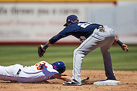 New Orleans Zephyrs shortstop Juan Diaz #29 attempts to tag Round Rock Express base runner Brad Snyder slides back into second base during the Pacific Coast League baseball game on May 4, 2014 at the Dell Diamond in Round Rock, Texas. The Express defeated the Zephyrs 15-12. (Andrew Woolley/Four Seam Images)