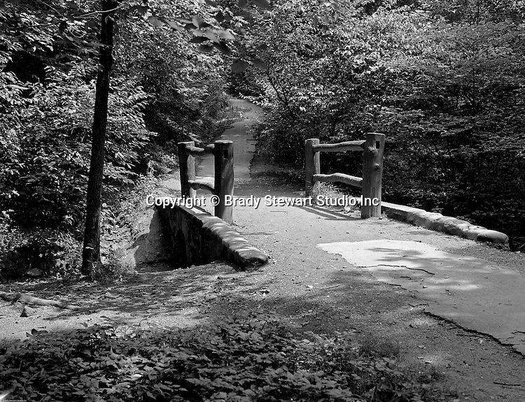 Pittsburgh PA.  A walking path in Frick Park. The park was created after a gift was made to the city of Pittsburgh by Henry Clay Frick.  When he died in 1919, Frick bequeathed to the city 151 acres south of his Point Breeze mansion, Clayton, and provided a $2 million trust fund to help create the park and assist with its long-term maintenance. The city began moving in earnest to create the park in 1925, when it acquired 190 additional acres, presumably with the goal to create a park of similar size and scope to Schenley and Highland Parks. The park officially opened in 1927.