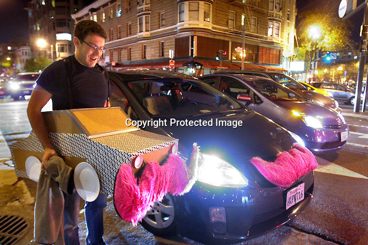 Lyft passenger Solon Aposhian got in the spirit of Halloween in dressing up as a Lyft car during Halloween weekend Friday, October 27, 2013.  Solon got a ride from driver Frederic Larson from Polk and Washington Street to Valencia and Market.  The ride ended as we where surrounded by Critical Mass Bike parade west on Market Street. .