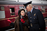 "© Joel Goodman - 07973 332324 . 24/05/2014 . Heywood Station , Railway Street , Heywood, UK . L-R Jane Francis (aka "" Lancashire Belle "") and former Flight Lieutenant Donald Ryan , who flew light aircraft in the RAF in the 1950s , singing hits from the 1940s on the platform . 1940s weekend on the East Lancs Railway , with visitors dressed up and partaking in 40s-themed events . Photo credit : Joel Goodman"