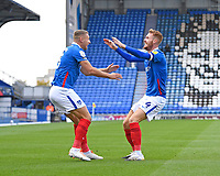 Tom Naylor of Portsmouth right celebrates the first goal during Portsmouth vs MK Dons, Sky Bet EFL League 1 Football at Fratton Park on 10th October 2020