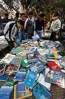 Young men look at second hand school books at a Sunday marked. Srinagar, Kashmir, India. © Fredrik Naumann/Felix Features