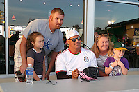 Former major leaguer Jose Canseco signs autographs and poses for a photo with a family during a game between the Hagerstown Suns and Lexington Legends on May 22, 2015 at Whitaker Bank Ballpark in Lexington, Kentucky.  Lexington defeated Hagerstown 5-1.  (Mike Janes/Four Seam Images)