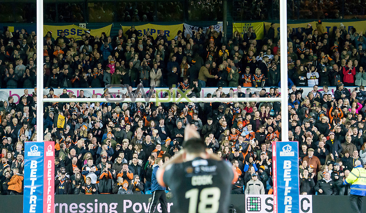 Picture by Allan McKenzie/SWpix.com - 23/03/2018 - Rugby League - Betfred Super League - Leeds Rhinos v Castleford Tigers - Elland Road, Leeds, England - Castleford's fans celebrate their victory over Leeds.