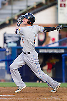 Tyler Naquin (4) of the Akron Rubber Ducks follows through on his swing against the Reading Fightin Phils at FirstEnergy Stadium on June 19, 2014 in Wappingers Falls, New York.  The Rubber Ducks defeated the Fightin Phils 3-2.  (Brian Westerholt/Four Seam Images)
