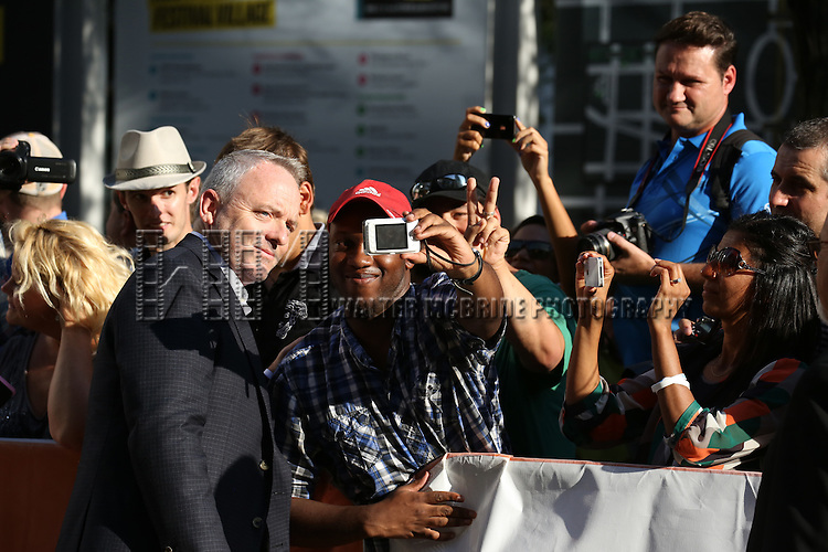 Dennis Lehane greets fans as he attends the 'The Drop' premiere during the 2014 Toronto International Film Festival at Princess of Wales Theatre on September 5, 2014 in Toronto, Canada.