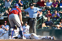 Rochester Red Wings outfielder Daniel Ortiz (39) is called safe by umpire Joseph Born after sliding past catcher Erik Kratz (39) during the second game of a doubleheader against the Buffalo Bisons on July 6, 2014 at Frontier Field in Rochester, New  York.  Rochester defeated Buffalo 6-1.  (Mike Janes/Four Seam Images)