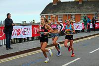 3rd October 2021; London, England: The Virgin Money 2021 London Marathon: Eloise Wellings of Australia and Natasha Cockram  of Great Britain crossing Narrow Street Swing Bridge, Limehouse Basin between mile 14 and 15.