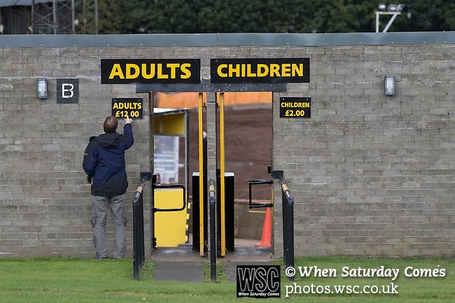 23.08.2014 Berwick-upon-Tweed, England. A groundsman putting up an admission price sign outside Shielfield Park, before the Scottish League Two fixture between Berwick Rangers and East Stirlingshire. The home club occupied a unique position in Scottish football as they are based in Berwick-upon-Tweed, which lies a few miles inside England. Berwick won the match by 5-0, watched by a crowd of 509.