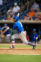 Dunedin Blue Jays left fielder Eduard Pinto (4) follows through on a swing during a game against the Clearwater Threshers on April 6, 2018 at Spectrum Field in Clearwater, Florida.  Clearwater defeated Dunedin 8-0.  (Mike Janes/Four Seam Images)