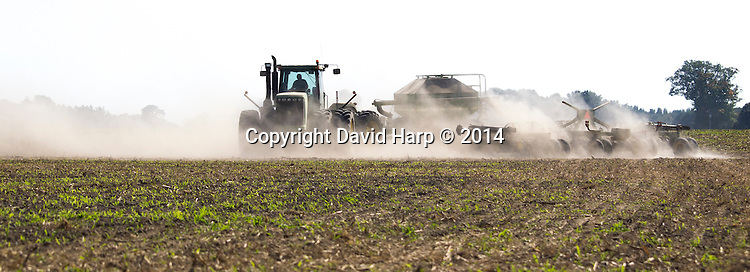 Bobby Hutchinson plants barley seed on a dry, dusty, October afternoon.