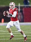 Southern Methodist Mustangs quarterback Garrett Gilbert (11) in action during heavy rainfall in the game between the Southern Methodist Mustangs and the TCU Horned Frogs at the Gerald J. Ford Stadium in Dallas, Texas. TCU defeats SMU 24 to 16..