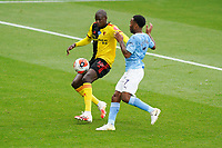 Abdoulaye Doucoure of Watford and Raheem Sterling of Man City during the Premier League match between Watford and Manchester City at Vicarage Road, Watford, England on 21 July 2020. Football Stadiums around remain empty due to the Covid-19 Pandemic as Government social distancing laws prohibit supporters inside venues resulting in all fixtures being played behind closed doors until further notice.<br /> Photo by Andy Rowland.