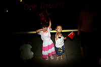 CHINA. Beijing. Children posing for a picture on Tiananmen Square during the Beijing 2008 Summer Olympics. 2008