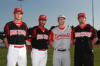 Batavia Muckdogs pitchers Chris Corrigan, LaCurtis Mayes, and Justin Edwards stand with former Muckdog Tyler LaVigne before a game vs. the Lowell Spinners at Dwyer Stadium in Batavia, New York July 16, 2010.   Batavia defeated Lowell 5-4 with a walk off RBI single in the bottom of the 9th inning.  Photo By Mike Janes/Four Seam Images