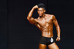 A bodybuilder competes in the Men's Athletic Physique over 170cm + 4kg category during the 2016 Hong Kong Bodybuilding Championships on 12 June 2016 at Queen Elizabeth Stadium, Hong Kong, China. Photo by Lucas Schifres / Power Sport Images