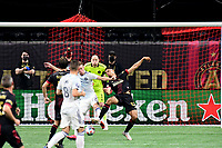 ATLANTA, GA - APRIL 24: Atlanta United defender #12 Miles Robinson and Chicago #27 Robert Beric compete for a ball during a game between Chicago Fire FC and Atlanta United FC at Mercedes-Benz Stadium on April 24, 2021 in Atlanta, Georgia.