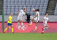 TOKYO, JAPAN - JULY 21: Lindsey Horan #9 of the USWNT heads the ball towards Tobin Heath #7 during a game between Sweden and USWNT at Tokyo Stadium on July 21, 2021 in Tokyo, Japan.