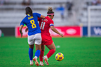 ORLANDO, FL - FEBRUARY 24: Desiree Scott #11 of the CANWNT battles for the ball during a game between Brazil and Canada at Exploria Stadium on February 24, 2021 in Orlando, Florida.
