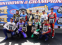 Sept. 14, 2012; Concord, NC, USA: NHRA pro stock motorcycle countdown to the championship riders top row (L-R) Karen Stoffer, Scotty Pollacheck , L.E. Tonglet, Michael Ray , Shawn Gann and Matt Smith.  Bottom row (L-R) Hector Arana Jr, Eddie Krawiec, Andrew Hines and Hector Arana Sr during qualifying for the O'Reilly Auto Parts Nationals at zMax Dragway. Mandatory Credit: Mark J. Rebilas-