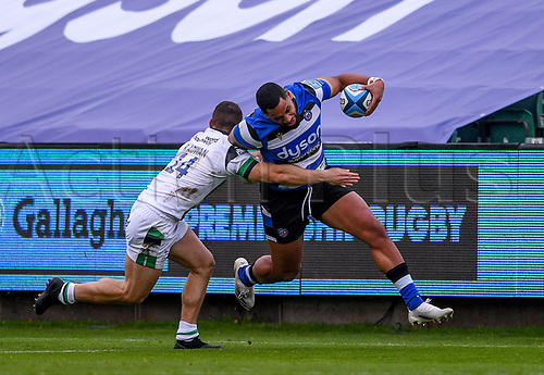 21st November 2020; Recreation Ground, Bath, Somerset, England; English Premiership Rugby, Bath versus Newcastle Falcons; Joe Cokanasiga of Bath tries to hand off Adam Radwan of Newcastle Falcons