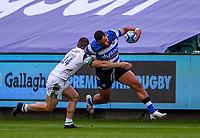 21st November 2020; Recreation Ground, Bath, Somerset, England; English Premiership Rugby, Bath versus Newcastle Falcons; Joe Cokanasiga of Bath tries to hand off Adam Radwan of Newcastle Falcons