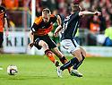 Dundee Utd's Chris Erskine gets away from Dundee's Simon Ferry.